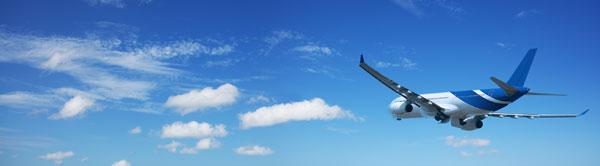 Plane flying across a blue sky